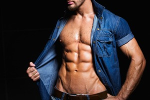 Background with muscular and sexy body of young man in jeans shirt